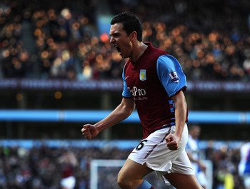 BIRMINGHAM, ENGLAND - FEBRUARY 26: Stewart Downing of Aston Villa roars with delight after scoring the third goal during the Barclays Premier League match between Aston Villa and Blackburn Rovers at Villa Park on February 26, 2011 in Birmingham, England.