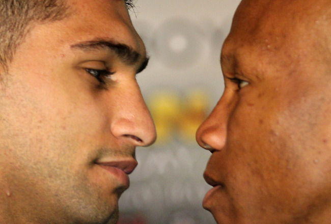 LOS ANGELES, CA - JUNE 8:   Amir Khan (L) and Zab Judah face off at a press conference to discuss their upcoming Super Lightweight World Championship Unification Fight at ESPN Zone At L.A. Live on June 8, 2011 in Los Angeles, California. (Photo by Stephen