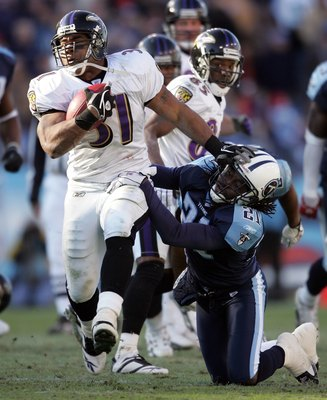 NASHVILLE, TN - NOVEMBER 12: Jamal Lewis #31 of the Baltimore Ravens runs with the ball while defended by Reynaldo Hill #21 of the Tennessee Titans on November 12, 2006 at LP Field in Nashville, Tennessee. (Photo by Andy Lyons/Getty Images)