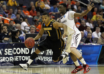 WASHINGTON - MARCH 17: Phil (Flip) Pressey #1 of the Missouri Tigers brings the ball past Cashmere Wright #1 of the Cincinnati Bearcats  during the second round of the 2011 NCAA men's basketball tournament at the Verizon Center on March 17, 2011 in Washin