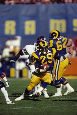 ANAHEIM, CA - DECEMBER 23:  Running back Eric Dickerson #29 of the Los Angeles Rams looks for room to run against the New York Giants during the 1984 NFC Wild Card playoff game at Anaheim Stadium on December 23, 1984 in Anaheim, California.   The Giants w