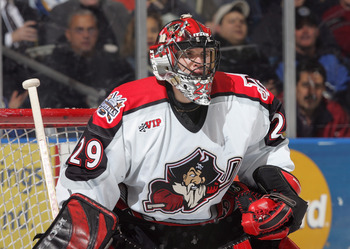 BRIDGEPORT, CT - DECEMBER 28:  Maxime Ouellet #29 of Portland Pirates stands ready in net during a American Hockey League game against the Bridgeport Sound Tigers at the Arena at Harbor Yard on December 28, 2004 in Bridgeport, Connecticut.  The Pirates wo
