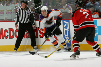 PHILADELPHIA - OCTOBER 9:  Right wing Pat Kavanagh #15 of the Philadelphia Phantoms skates past defenseman Bobby Allen #2 of the Albany River Rats on October 9, 2005 at the Wachovia Center in Philadelphia, Pennsylvania.  The Phantoms won 4-2.  (Photo by B