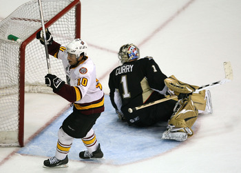 ROSEMONT, IL - JUNE 10: Jason Krog #10 of the Chicago Wolves celebrates his third goal of the game as John Curry #1 of the Wilkes-Barre/Scranton Penguins looks for the puck during the Calder Cup Finals on June 10, 2008 at the Allstate Arena in Rosemont, I