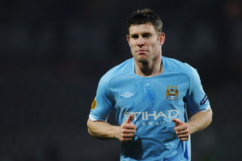 TURIN, ITALY - DECEMBER 16:  James Milner of Manchester City looks on during the UEFA Europa League group A match between Juventus FC and Manchester City at Stadio Olimpico di Torino on December 16, 2010 in Turin, Italy.  (Photo by Valerio Pennicino/Getty