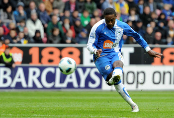 WIGAN, ENGLAND - MAY 15:  Charles N'Zogbia of Wigan Athletic scores his team's first goal during the Barclays Premier League match between Wigan Athletic and West Ham United at the DW Stadium on May 15, 2011 in Wigan, England.  (Photo by Chris Brunskill/G