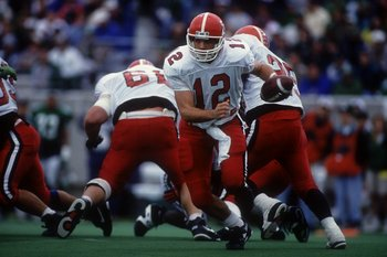 18 DECEMBER 1993: MARK BRUNGARD ( 12 ) OF THE PENGUINS IN ACTION AS YOUNGSTOWN STATE PENGUINS 17 DEFEATED MARSHALL THUNDERING HERD 5 AT MARSHALL UNIVERSITY STADIUM