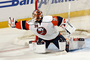SUNRISE, FL - OCTOBER 6: Goaltender Rick DiPietro #39 of the New York Islanders makes a glove save against the Florida Panthers in preseason action at the Bank Atlantic Center on October 6, 2008 in Sunrise, Florida. (Photo by Eliot J. Schechter/Getty Imag