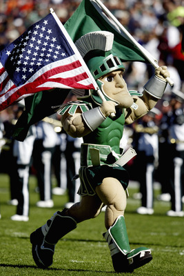 EAST LANSING, MI - OCTOBER 9:  Sparty, the Michigan State University Spartans mascot, carries the American Flag during the game against the University of Illinois Fighting Illini at Spartan Stadium on October 9, 2004 in East Lansing, Michigan. Michigan St