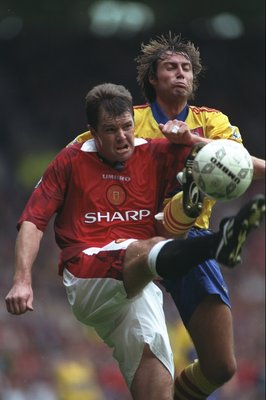 4 Oct 1997:  Gary Pallister of Manchester United is challenged by Paul Warhurst of Crystal Palace during the FA Carling Premiership match at Old Trafford in Manchester, England. Manchester United won the match 2-0. \ Mandatory Credit: Clive Brunskill /All