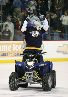 NASHVILLE, TN - JANUARY 10: The mascot Gnash of the Nashville Predators rides a atv on the ice during the game against the New York Islanders at the Gaylord Enterntainment Center on January 10, 2006 in Nashville, Tennessee. (Photo by: Bruce Bennett/Getty