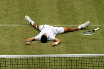 LONDON, ENGLAND - JULY 03:  Novak Djokovic of Serbia celebrates championship point after winning  his final round Gentlemen's match against Rafael Nadal of Spain on Day Thirteen of the Wimbledon Lawn Tennis Championships at the All England Lawn Tennis and