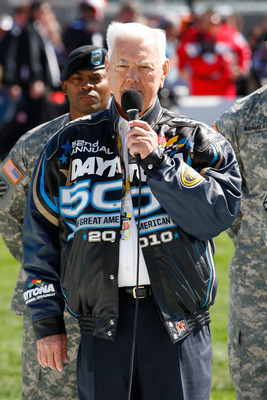 DAYTONA BEACH, FL - FEBRUARY 14:  NASCAR legend Junior Johnson speaks in front of service members during pre-race ceremonies for the NASCAR Sprint Cup Series Daytona 500 at Daytona International Speedway on February 14, 2010 in Daytona Beach, Florida.  (P