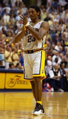 INDIANAPOLIS - MAY 22:  Ron Artest #23 of the Indiana Pacers claps in the final moments of the Pacers' win over the Detroit Pistons in Game one of the Eastern Conference Finals during the 2004 NBA Playoffs on May 22, 2004 at Conseco Fieldhouse in Indianap