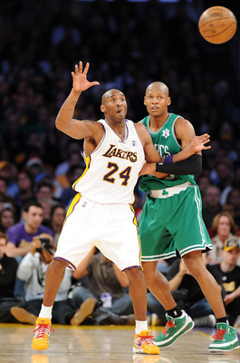 LOS ANGELES, CA - DECEMBER 25:  Kobe Bryant #24 of the Los Angeles Lakers signals for the ball under pressure from Ray Allen #20 of the Boston Celtics at Staples Center on December 25, 2008 in Los Angeles, California.  The Lakers defeated the Celtics 92-8