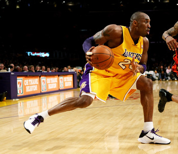 LOS ANGELES, CA - DECEMBER 29:  Kobe Bryant #24 of the Los Angeles Lakers drives against the Golden State Warriors on December 29, 2009 at Staples Center in Los Angeles, California.  The Lakers won 124-118.  NOTE TO USER: User expressly acknowledges and a