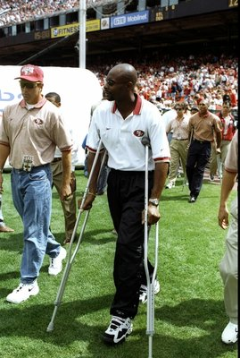 14 Sep 1997:  An injured wide receiver Jerry Rice of the San Francisco 49ers looks on during a game against the New Orleans Saints at 3Com Park in San Francisco, California.  The 49ers won the game, 33-7.  Rice was injured in game one of the season versus