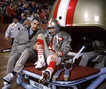 SAN FRANCISCO - DECEMBER 14:  Quarterback Joe Montana #16 of the San Francisco 49ers leaves for the locker room after for treatment on an injury during a game against the Chicago Bears at Candlestick Park on December 14, 1987 in San Francisco, California.