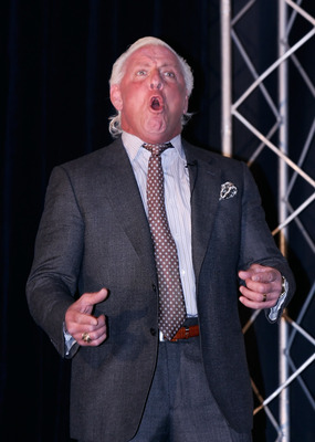 CONCORD, NC - JANUARY 20:  Former American Professional Wrestler Ric Flair performs his famous yell 'Wooooo!', for the media during the NASCAR Sprint Media Tour hosted by Charlotte Motor Speedway, held at the Embassy Suites, on January 20, 2010 in Concord