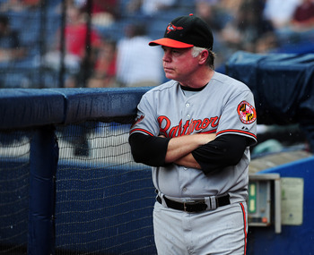 ATLANTA - JULY 3: Manager Buck Showalter #26 of the Baltimore Orioles watches the action against the Atlanta Braves at Turner Field on July 3, 2011 in Atlanta, Georgia. (Photo by Scott Cunningham/Getty Images)