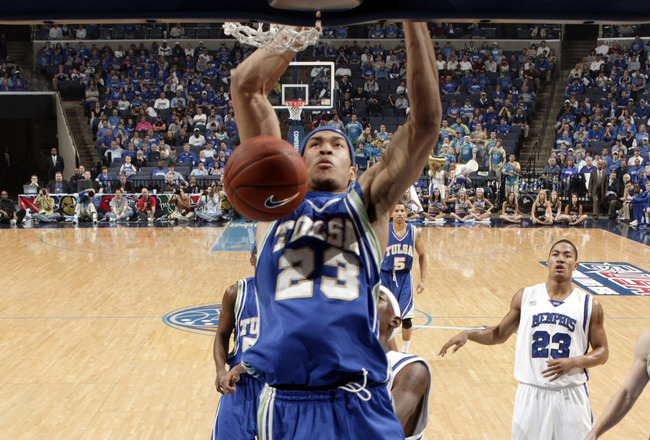 MEMPHIS, TN - MARCH 15: Jerome Jordan #23 of the Tulsa Golden Hurricane dunks the ball past Robert Dozier #2 of the Memphis Tigers during the finals of the Conference USA Basketball Tournament at FedexForum on March 15, 2008 in Memphis, Tennessee. (Photo