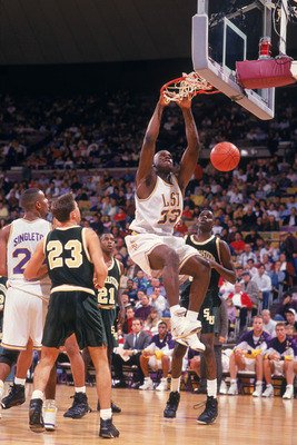 1991:  Shaquille O'Neal #33 of the Louisiana State University Tigers makes a slam dunk during an NCAA game against the Southeastern Louisiana University LIons in 1991.  (Phot by Brad Messina/Getty Images)