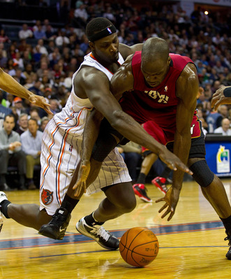 CHARLOTTE, NC - JANUARY 03: Kwame Brown #54 of the Charlotte Bobcats battles for a loose ball with Joel Anthony #50 of the Miami Heat at Time Warner Cable Arena on January 3, 2011 in Charlotte, North Carolina.  The Heat defeated the Bobcats 96-82.  (Photo