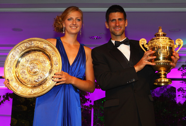 LONDON, ENGLAND - JULY 03:  Novak Djokovic of Serbia and Petra Kvitova of Czech Republic hold their winners trophies at the Wimbledon Championships 2011 Winners Ball at the InterContinental Park Lane Hotel on July 3, 2011 in London, England.  (Photo by Cl