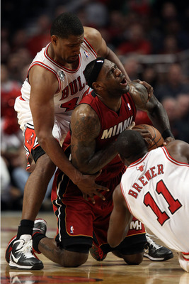 CHICAGO, IL - MAY 26:  LeBron James #6 of the Miami Heat fights for a loose ball against Kurt Thomas #40 and Ronnie Brewer #11 of the Chicago Bulls in Game Five of the Eastern Conference Finals during the 2011 NBA Playoffs on May 26, 2011 at the United Ce
