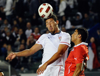 CARSON, CA - JANUARY 22:  Omar Gonzalez #4 United States goes for a header against Paulo Magalhaes #16 of Chile against of the  during the friendly soccer match at The Home Depot Center on January 22, 2011 in Carson, California.  (Photo by Kevork Djansezi