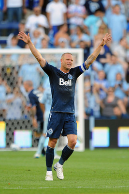 KANSAS CITY, KS - JUNE 25:  Jay DeMerit #6 of Vancouver Whitecaps FC celebrates following a goal against the Sporting Kansas City on June 25, 2011 at LiveStrong Sporting Park in Kansas City, Kansas. (Photo by G. Newman Lowrance/Getty Images)