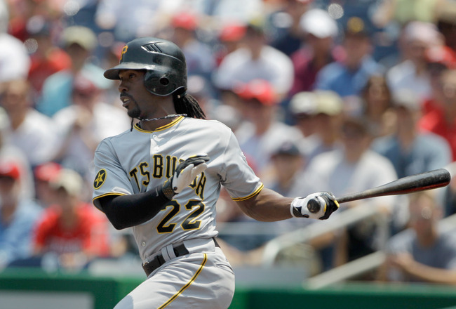 WASHINGTON, DC - JULY 03: Andrew McCutchen #22 of the Pittsburgh Pirates follows his RBI single against the Washington Nationals during the first inning at Nationals Park on July 3, 2011 in Washington, DC.  (Photo by Rob Carr/Getty Images)
