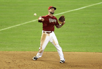 PHOENIX, AZ - JUNE 29:  Infielder Ryan Roberts #14 of the Arizona Diamondbacks fields a ground ball out against the Cleveland Indians during the Major League Baseball game at Chase Field on June 29, 2011 in Phoenix, Arizona.  The Indians defeated the Diam