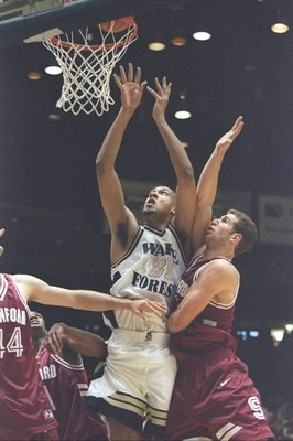 16 Mar 1997:  Center Tim Duncan of the Wake Forest Demon Deacons and center Tim Young of the Stanford Cardinals fight for a rebound during a playoff game at the McKale Center in Tuscon, Arizona .  The Cardinals won the game 72 - 66. Mandatory Credit: Bria