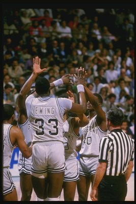 1984:  Center Patrick Ewing of the Georgetown Hoyas high fives his teammates during a game. Mandatory Credit: Allsport  /Allsport