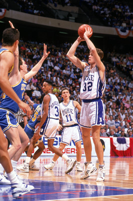 UNDATED:  Christian Laettner #32 of the Duke University Blue Devils looks to pass during an NCAA game in 1990.  (Photo by Getty Images)