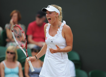 LONDON, ENGLAND - JUNE 27:  Caroline Wozniacki of Denmark reacts to a play during her fourth round match against Dominika Cibulkova of Slovakia on Day Seven of the Wimbledon Lawn Tennis Championships at the All England Lawn Tennis and Croquet Club on June