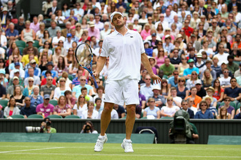 LONDON, ENGLAND - JUNE 24:  Andy Roddick of the United States reacts to a play during his third round match against Feliciano Lopez of Spain on Day Five of the Wimbledon Lawn Tennis Championships at the All England Lawn Tennis and Croquet Club on June 24,