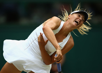 LONDON, ENGLAND - JULY 02:  Maria Sharapova of Russia in action during her Ladies' final round match against Petra Kvitova of the Czech Republic on Day Twelve of the Wimbledon Lawn Tennis Championships at the All England Lawn Tennis and Croquet Club on Ju