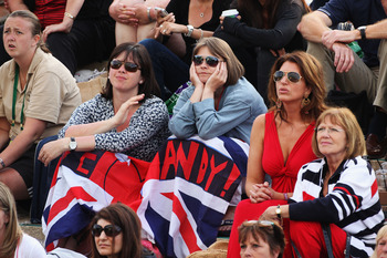LONDON, ENGLAND - JULY 01:  Tennis spectators watch Andy Murray's semi final match against Rafael Nadal of Spain on Day Eleven of the Wimbledon Lawn Tennis Championships at the All England Lawn Tennis and Croquet Club on July 1, 2011 in London, England. M