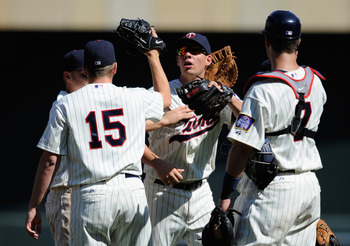 MINNEAPOLIS, MN - JULY 3: Glen Perkins #15, Danny Valencia #19 and Joe Mauer #7 of the Minnesota Twins celebrate a win against the Milwaukee Brewers on July 3, 2011 at Target Field in Minneapolis, Minnesota. The Twins defeated the Brewers 9-7. (Photo by H