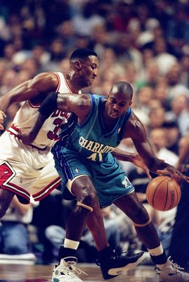 13 May 1998: Glen Rice of the Charlotte Hornets dribbles the ball as Scottie Pippen of the Chicago Bulls tries to block at the United Center in Chicago, Illinios. The Bulls defeated the Hornets 93-84. Mandatory Credit: Jonathan Daniel  /Allsport