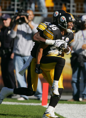 PITTSBURGH - NOVEMBER 7:  Split end Plaxico Burress #80 of the Pittsburgh Steelers celebrates with his teammate flanker Hines Ward #86 during the game against the Philadelphia Eagles at Heinz Field on November 7, 2004 in Pittsburgh, Pennsylvania. The Stee