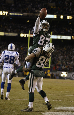 EAST RUTHERFORD, NJ - JANUARY 4:  Santana Moss #83 of the New York Jets is lifted in celebration by teammate Wayne Chrebet #80 after Moss scored a touchdown against the Indianapolis Colts during the AFC wildcard game at Giants Stadium on January 4, 2003 i
