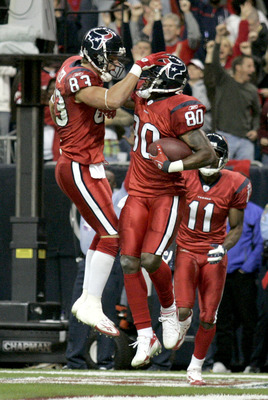 HOUSTON - DECEMBER 13:  Kevin Walter #83 celebrates a touchdown with Andre Johnson #80 of the Houston Texans during the NFL game against the Denver Broncos at  Reliant Stadium on December 13, 2007 in Houston, Texas. (Photo by Thomas B.  Shea/Getty Images)