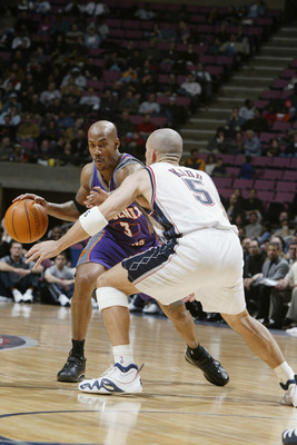 EAST RUTHERFORD, NJ - DECEMBER 9:  Guard Stephon Marbury #3 of the Phoenix Suns dribbles against guard Jason Kidd #5 of the New Jersey Nets during the game at Continental Airlines Arena on December 9, 2002 in East Rutherford, New Jersey.  The Nets won 106