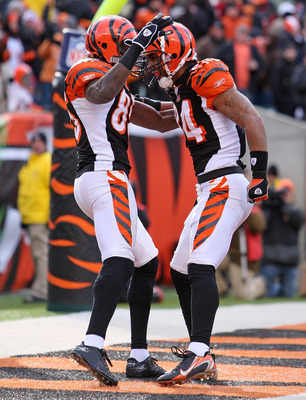 CINCINNATI - DECEMBER 23: T. J. Houshmandzadeh #84 of the Cincinnati Bengals celebrates with teammate Chad Johnson #85 after Houshmandzadeh caught a touchdown pass during the NFL game against the Cleveland Browns at Paul Brown Stadium December 23, 2007 in