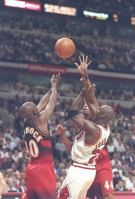 6 May 1997: Guard Mookie Blaylock and forward Alan Hernderson of the Atlanta Hawks fight for the ball with guard Michael Jordan of the Chicago Bulls during a playoff game at the United Center in Chicago, Illinois.