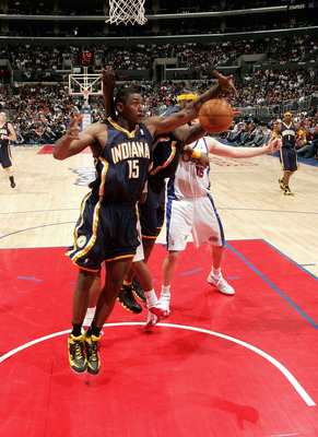 LOS ANGELES - NOVEMBER 27:  Ron Artest #15 of the Indiana Pacers grabs a loose ball against the Los Angeles Clippers on November 27, 2005 at Staples Center in Los Angeles, California. The Pacers won 97-92. NOTE TO USER: User expressly acknowledges and agr