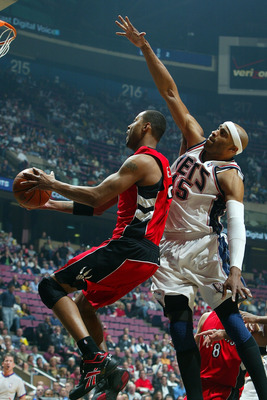EAST RUTHERFORD, NJ - MAY 04:  Vince Carter #15 of the New Jersey Nets defends Morris Peterson #24 of the Toronto Raptors in Game Six of the Eastern Conference Quarterfinals during the 2007 NBA Playoffs on May 4, 2007 at the Continental Airlines Arena at